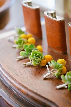 Succulent boutonniers and leather flasks for the groomsmen - style!!