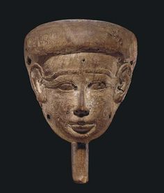 AN EGYPTIAN WOOD MUMMY MASK LATE PERIOD TO PTOLEMAIC PERIOD, 664-30 B.C.