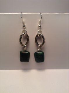Green and silver dangle earrings by Shaylasjewelrybox on Etsy