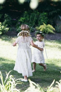 Sophie Green & Matt Kliegman's Canadian Farm Wedding - Our flower girls playing in the grass before dinner.