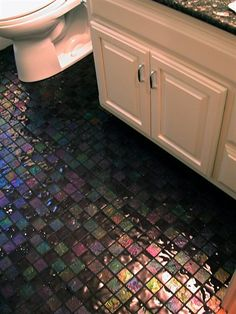 Love this flooring!! http://www.lightstreamsglasstile.com/siteimages/0_Lightstreams_Glass_Bathroom_Floor_Tile_Dark_Silver_Grey_Black.JPG