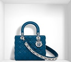 An iconic bag for a look worthy of a true Lady. It is carried in the hand to add the finishing touch to a look that's so Dior: An iconic bag from the House of Dior, the Lady Dior features the woven 'cannage' design found on the Napoleon III chairs that Christian Dior loved so dearly. www.italianist.com