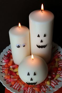 Halloween Candles, i would do orange candels for the pumpkin faces tho