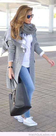 Blue jeans, and a long grey coat