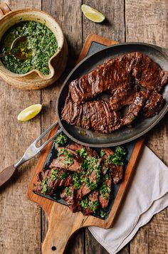 Grilled skirt steak with lots of chimichurri is a perfect summertime meal. This recipe gives you a simple, well-salted grilled skirt steak topped with deliciously verdant, garlicky, and slightly spicy chimichurri.