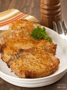 Oven-Fried Parmesan Pork Chops - tender, juicy pork chops coated with a blend of breadcrumbs, seasoning and parmesan cheese