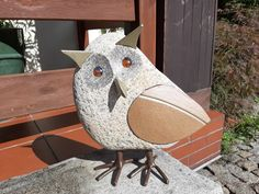 owl, birds sculpture made of stone (gray granite), steel and glass (eyes)