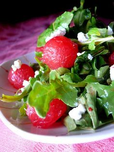 Watermelon + Feta Salad ~ Seedless watermelon balls, arugula greens, diced red onion, goat's cheese, and raspberry vinaigrette.