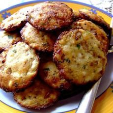 Savoury Ricotta Snacks 1 lb ricotta cheese (fresh) 1 onion (large, finely chopped) 2 tbsps oil (for frying) 11/2 tbsps balsamic vinegar 1/2 cup sharp cheddar cheese 1/2 cup parmesan cheese 1 tbsp lemon zest (the zest of 1 lemon) 1 tsp black pepper (coarse) 1 tsp salt 2 tsps baking powder 2 tbsps parsley (finely chopped) 2 large eggs (beaten) 3 tbsps olive oil (or 3 tablespoons flax seed oil)