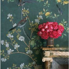 Details from our 'Jardinieres & Citrus Trees' hand painted wallpaper, interior design by @charmossny #charlottemoss #handpaintedwallpaper #chinoiserie #degournay #silkwallpaper #diningroom #details #mantleplace #interiors #interiordesign