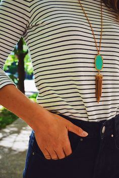 High waisted black shorts, striped tee, tassel necklace and aviator = a casual summer outfit that you can re-create.
