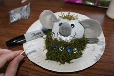 Make a troll rock friend - Frozen; also might be neat to model a savory cheeseball design  after this with parsley serving as the moss.