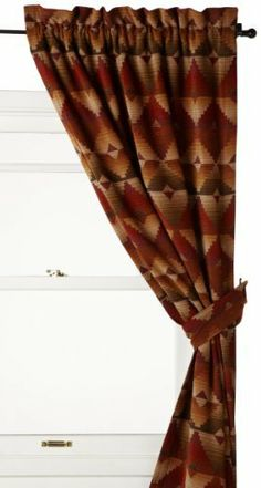 """Croscill Santa Fe Pole Top Drape by Croscill. $124.99. Coordinating comforter set, decorative pillows and valance are available. The rod pocket can accommodate both decorative and continental rods. Each panel is fully lined and has sewn in weights in each bottom corner. Dry clean only. Pole top drape includes two 41-inch wide by 84-inch long panels and two tiebacks. Croscill's """"Santa Fe"""" is a rustic southwestern ensemble in a warm desert palette of cayenne, sage, sand ..."""