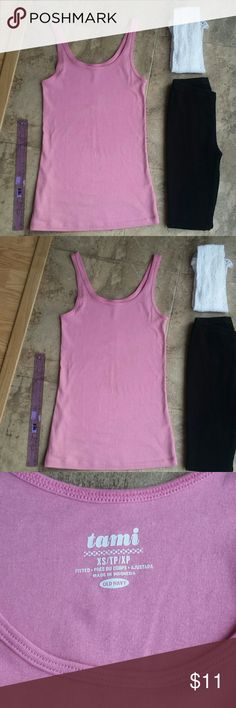"XS Pretty pink Tank top + Leggings +Bebe gifts* Excellent condition XS pretty pink tami tank top. Measures flat down 24"" shoulder top to bottom end.  XS black ribbed leggings by boutique worn 1x best for small/petite short. White XS bebe gift of design stockings worn 2x/washed. *Includes gift of authentic original wooden bebe pant hanger not in pics.   See rest of my closet for deals and to save on shipping if add more items. See free gifts in closet too. Pet free smoke free home. *5 star…"