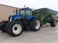 New Holland T8030 with  Brent 1080 grain cart seen at Tri Green Tractor in Flora