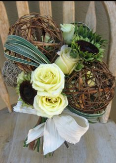 Twig & moss spheres/White Roses/Petal-less Sunflowers/Variegated Lily Grass Bouquet by Jacqueline Ahne