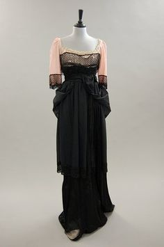 Black crepe dress with pink inner bodice and net trim, c.1912