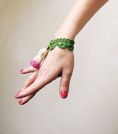Add a fresh touch of color with a statement-making bracelet.