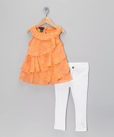 Take a look at this Orange Ruffle Tunic & White Jeggings - Infant & Toddler by Calvin Klein on #zulily today!