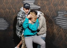 hidden camera in a haunted house....these pictures are hilarious!!! no shame in holding hands...even for grown men!