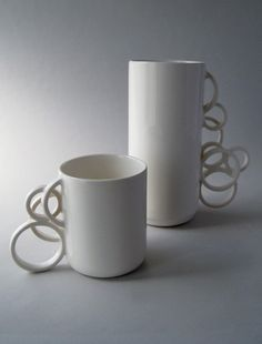 tea-cup and coffee cup. LOL I'd spill the cup of tea or coffee trying to get my finger in the right spot ~!~