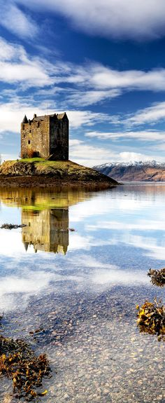 Beautiful Castle Stalker reflecting on Loch Linnhe in the west coast of Scotland