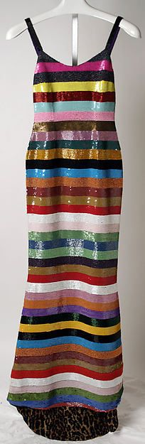 Todd Oldhams evening dress from fall/winter 1994-1995. It is American and made of synthetic and plastic. The scoop neck with small straps was widely seen in the 90s for dresses.
