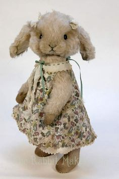 "Blossom By The Rabbit Maker - Blossom is made from pale pinky grey coloured curly kid mohair, with cream faux fur in her ears, and an alpaca tail. Shemeasures approximately 11.5"" to the top of her head. She has been scissor sculpted and airbrushed to enhance her facial features.Blossom has lop ea..."