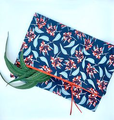 This gorgeous fold over cotton clutch features an adorable gum nut fabric by Australiana guru Jocelyn Proust. Bouquets of gum nuts are rhythmically interspersed with gum leaves on a navy background, this beautiful design is turned into a practical. Christmas Gift Guide, Christmas Shopping, Christmas Gifts, Australian Gifts, Navy Background, Craft Business, Compliments, Bouquets, Essentials