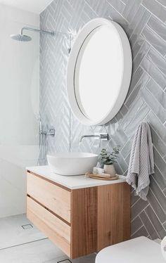 Grey herringbone subway tile on modern bathroom with floating vanity, white vessel sink and round mirror bathroom Minimalist Bathroom Design, Simple Bathroom Designs, Modern Bathroom Design, Bathroom Interior Design, Decor Interior Design, Modern Minimalist, Modern Bathroom Sink, Interior Ideas, Modern Bathrooms