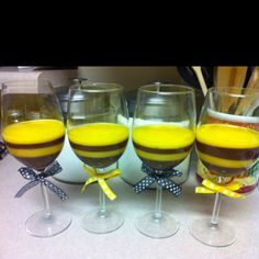 Pudding cups for bumble bee themed baby shower! Chocolate pudding layered with vanilla + yellow food coloring!