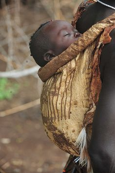 Africa | Me'en (Bodi) baby on his mother's back, Omo Valley, Ethiopia | © World Discoverer
