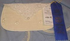 Rags to Riches Clutch Purse    FREE TUTORIAL available on this product - Click on TUTORIALS (top of website) OR click on the link listed under Additional Information (bottom of this page)    Embroider a clutch purse for a special occasion. Match the fabric and thread color to match your garment.