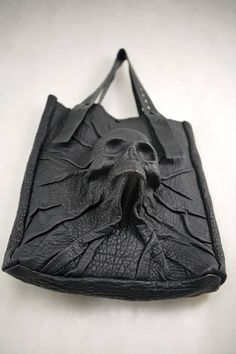 Devastating molded leather skull tote