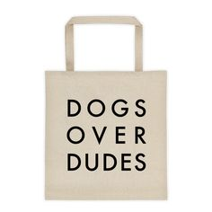 "Dogs Over Dudes Tote Bag. Looking for a useful, reusable tote bag with a funny dog saying? Is your dog the most important person in your life? Then you need this cute canvas bag with ""Dogs Over Dudes"" on it! Coco & Minnie is redefining the doggie bag - 12 oz, 100% cotton canvas with square, reinforced bottom & 22"" dual handles."