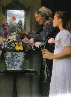 Tasha Tudor arranging flowers from her garden as seen on linenandllavender.net: