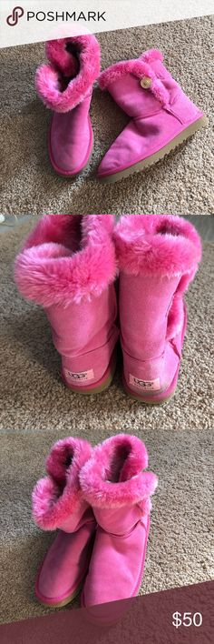 Size 9 wide UGG. Bright pink buttons have no face In pretty good condition bright pink UGGs buttons broken, not a lot of wear on them. There is some dirt on the back of the right boot as noted in pictures,  price reflects button issue. Thanks for looking. These are used. UGG Shoes Ankle Boots & Booties