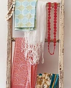 Ladder as decor piece for hanging scarves. Beautiful idea.