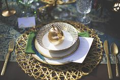 Peacock and Gold Inspired Place Setting | Cassandra Farley Photography | Winter Woodlands Wedding with Rich Bohemian Details and Luxe Jewel Tones