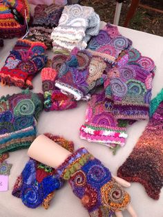 Multiple scrumbled hand warmers... Freeform crochet by Sharyn McNab