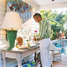 So need to do this on our porch!  Love the picture leaning against the wall and the lamp.  The painting is by Rick Worth, an artist residing in Key West who shows at the Lucky Street Gallery.