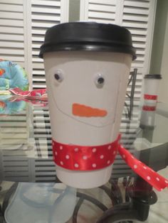 Cute snowman that's easy to make as a kids craft! We're filling ours up with popcorn treats or using them for hot cocoa! :)