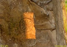 Sunbeam on the backstone of the chamber inside Cairn T at Loughcrew - 20th March 2009