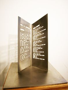 Central Booking » Alastair Noble - Blake Illuminated, 2002 Book sculpture – Stainless Steel, 18 x 10 x 5 inches (base 15 x 15 inches). $4500