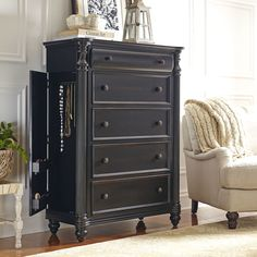 Everett Drawer Chest | Constructed from sturdy poplar hardwoods and birch veneers, the Everett Collection reflects Victorian design elements with rounded edges, clean lines, and hand-rubbed antique black finish. This five-drawer chest features matching wooden knobs and charming tapered bun feet.