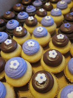 Mini cupcakes for a bridal shower with a chocolate brown and purple color scheme.