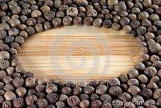Allspice peas close up on a cutting board.