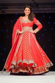 Pariniti Chopra wearing a dashing Red Double Layered Bridal Anarkali Suits