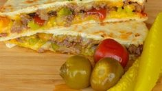 All the fixings for cheeseburgers (ground beef, cheese, ketchup, mustard, and relish) are cooked between tortillas in this cheeseburger quesadilla recipe.