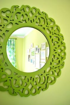 iinexpensive mirror from Marshalls   - it was originally black then painted green for a nursery and hung across from the window to bounce light around the room **another fab DIY from younghouselove**